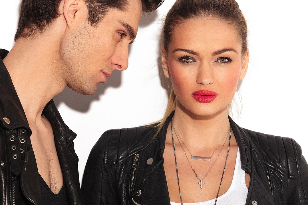 Young fashion couple in leather clothes